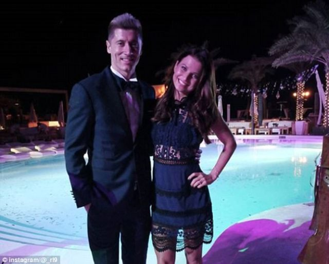 Bayern Munich striker Robert Lewandowski wears a classy tuxedo, wife Anna on his arm