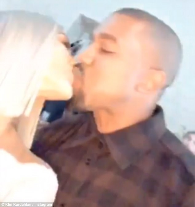 Kisses for the Mrs: Kim Kardashian shared her New Year's kiss with Kanye West on Sunday night, as they welcomed 2018 together