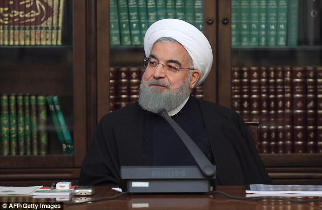 Iranian President Hassan Rouhani (pictured) has dismissed the protests taking place across Iran on Monday as 'nothing', in a bid to downplay the significance of the increasingly violent demonstrations