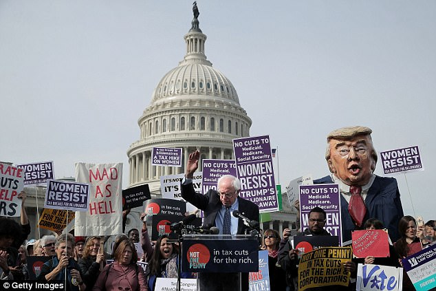 A witness said the grand jury that handed down indictments of two Trump associates 'looks like a Bernie Sanders rally.' Sen. Bernie Sanders (I-VT) addresses a rally against the Republican tax plan outside the U.S. Capitol November 1, 2017 in Washington, DC