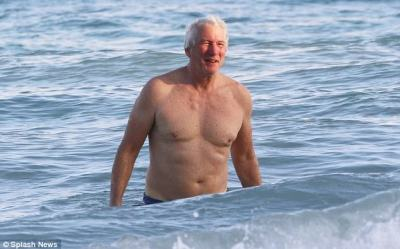 Plenty to smile about:In spite of the incident, the Hollywood icon was still smiling as he emerged from the ocean