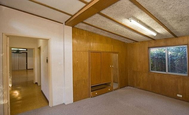 The large wood-finished home has five bedrooms, three bathrooms and a battle-axe driveway that leads to off-street parking