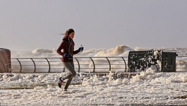 Certain to no longer let the storm receive in the intention of her effectively being routine, a girl jogged thru sea foam in Blackpool