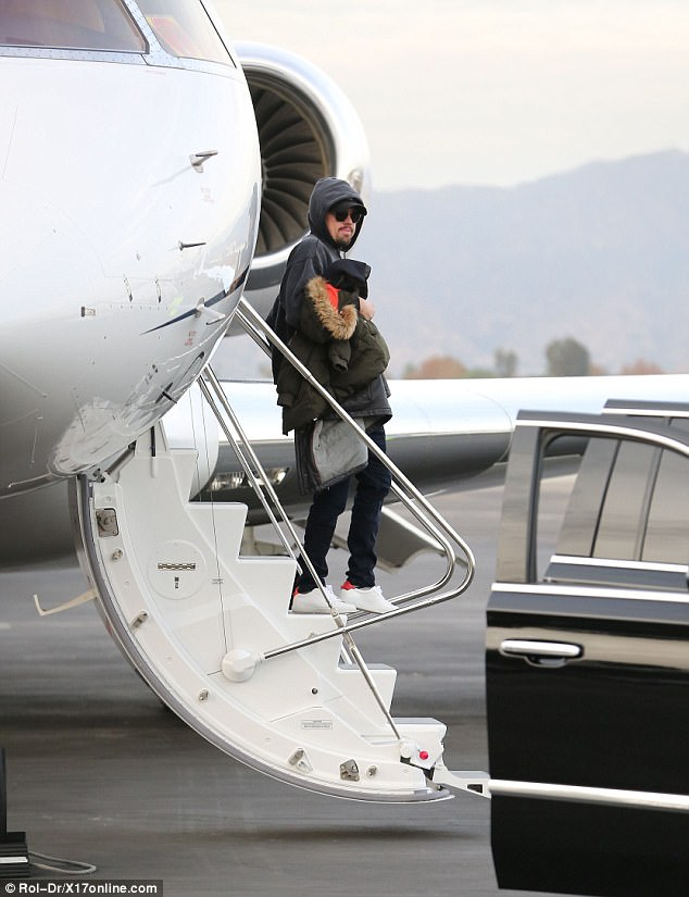 Air miles: EnvironmentalistDiCaprio's lavish mode of transport to get him back from his winter vacation in the upmarket ski resort will no doubt raise eyebrows