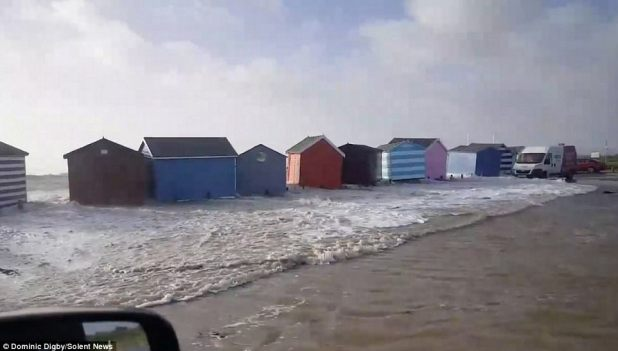 Seaside huts on Hayling Island, terminate to Portsmouth, were smashed by solid waves which left them floating in a flooded automotive park