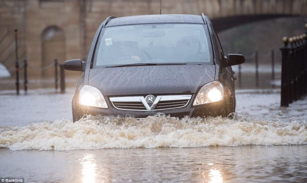 A motorist makes their intention thru the flooded streets of York the set the River Ouse broke its banks in a single day