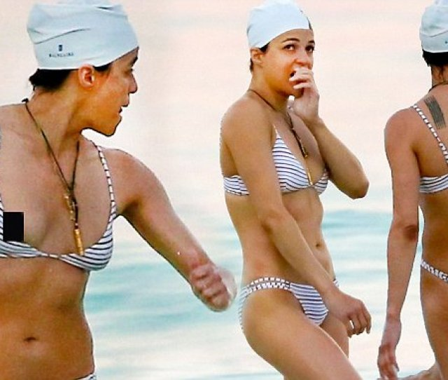 Bikini Clad Michelle Rodriguez Suffers An Accidental Nip Slip As She Braves The Waves In A Striped Two Piece In Mexico
