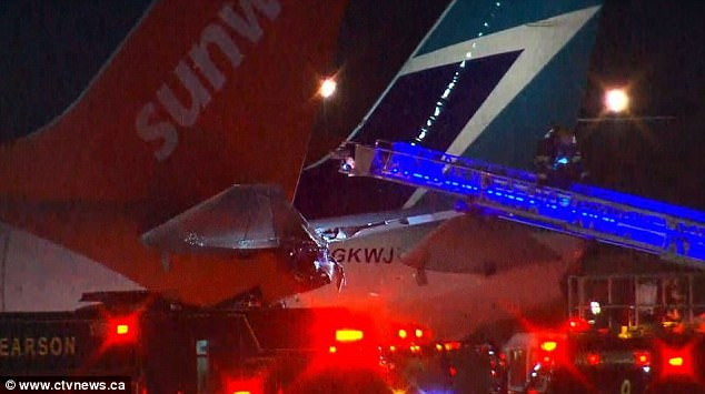 The damage to the rear of the Sunwing plane at Toronto Pearson International Airport after the collision