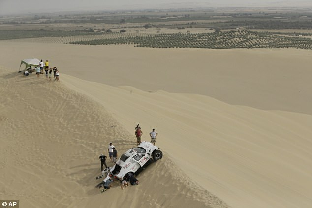 Spectators helped some of the stranded competitors recover their vehicles from the dunes