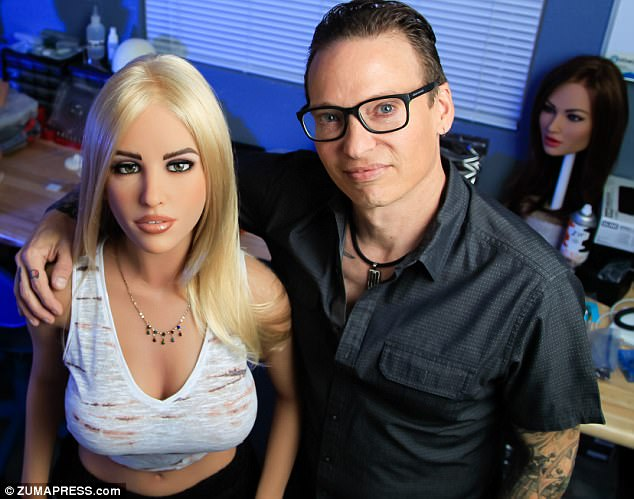 Founder and CEO ofRealbotix MattMcMullen (right) stands beside one of his female sex bot creations