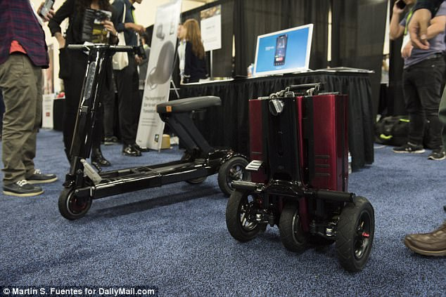 At CES Unveiled, the Relync  demonstrated for Dailymail.com how the three-wheeled scooter can be folded  in just two motions. Once it's all packed up, it's small enough to be brought onto a train or plane, taking up roughly the same amount of space as a carry-on suitcase