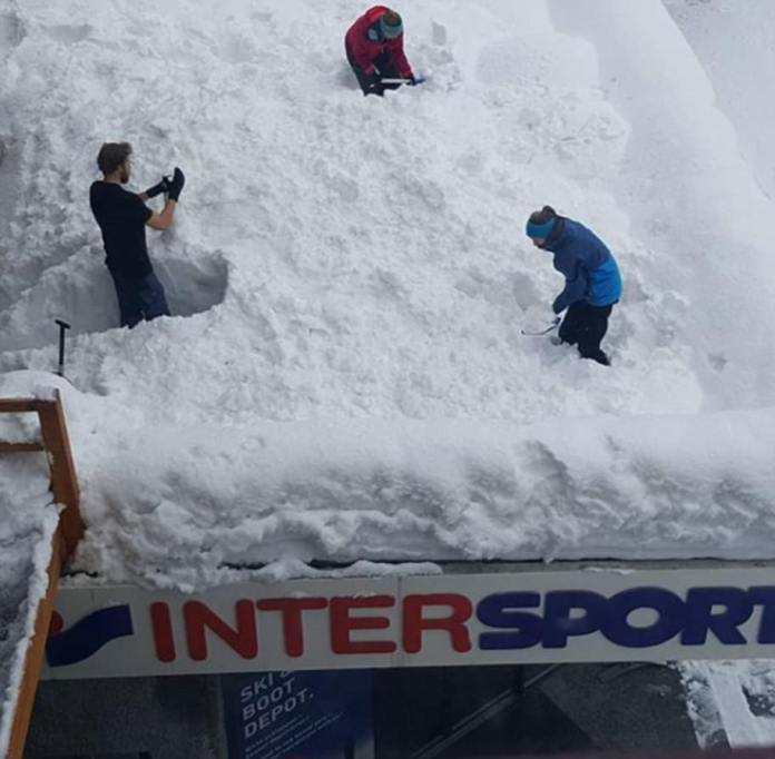 Spades out: Tourists dig holes in the snow using spades after becoming trapped at the Zermatt resort in Switzerland