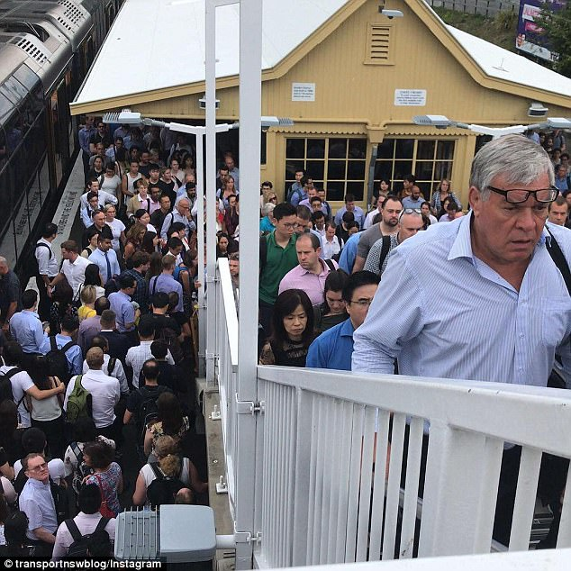 The city's train system collapsed on Tuesday, leaving thousands of passengers stranded and packed onto platforms in stormy weather