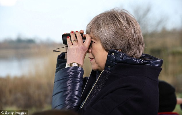 Theresa May (pictured at the London Wetland Centre on Thursday) said businesses should ban disposable cups and cutlery