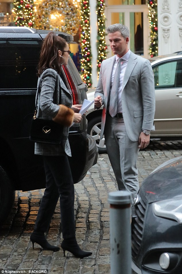 Chatting on the cobblestones: Her jacket featured fur cuffs - whether real or faux was unclear - and she had slung a black Fendi purse over her right shoulder