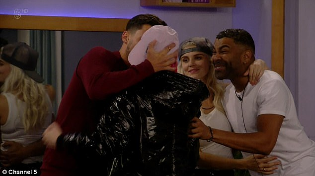 Pucker up! Andrew Brady, 26, took his bromance with the RuPaul's Drag Race star, 35, to new flirty heights on Friday, as they shared a playful kiss on Celebrity Big Brother