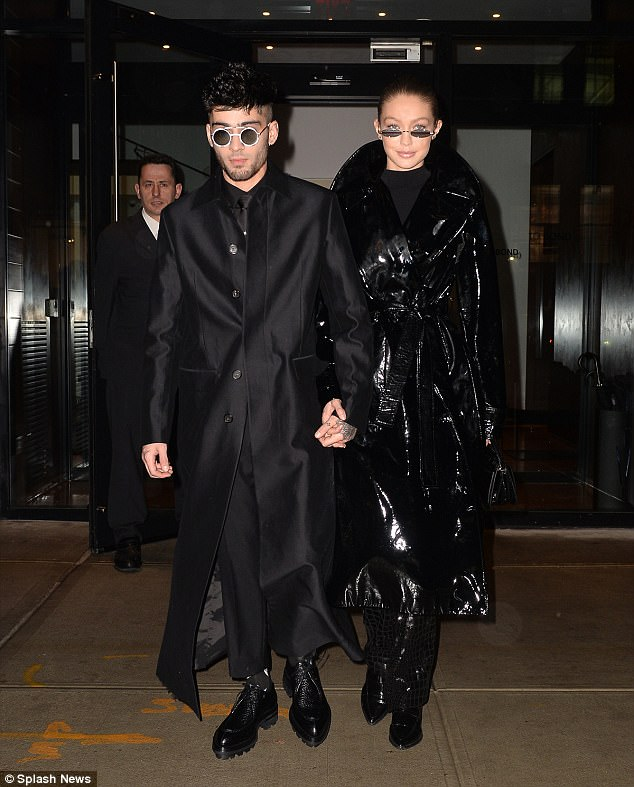 Enter the Matrix! Gigi Hadid and her boyfriend Zayn Malik looked as if they were about to enter The Matrix as they both stepped out in head-to-toe black outfits to celebrate the former One Direction singer's milestone 25th birthday