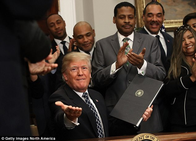 Trump, pictured after signing a proclamation to honor Martin Luther King Jr day, has blamed the media for distorting his meaning, according to a source speaking to the Associated Press