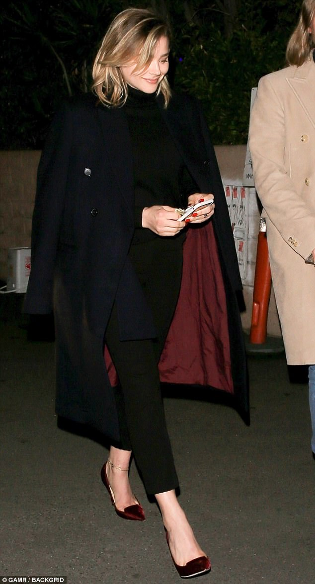 Lighting up the city: Chloe Grace Moretz looked chic in cigarette pants and a handsome coat Friday in Beverly Hills where she enjoyed sushi dinner with a friend at the upscale Matsuhisa