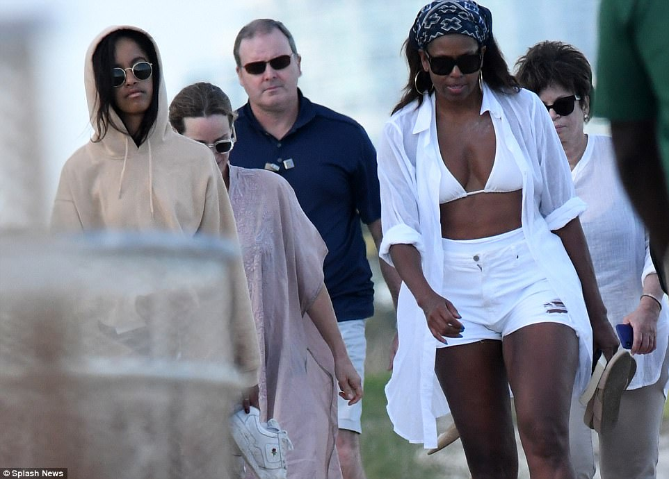 Just the two of us: Neither former president Barack nor the couple's youngest daughter Sasha were in sight