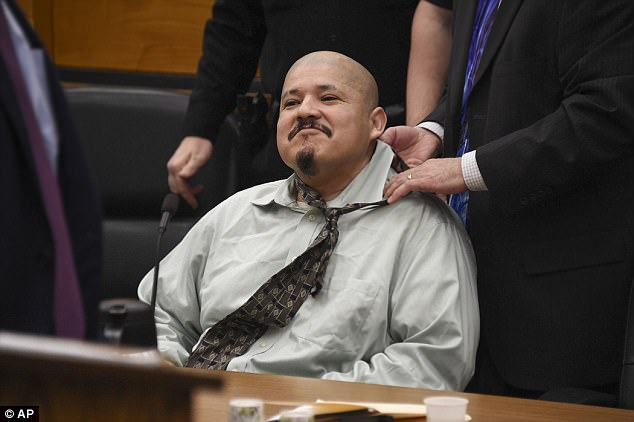 Bracamontes is seen here having a tie placed around his neck in Sacramento Superior Court