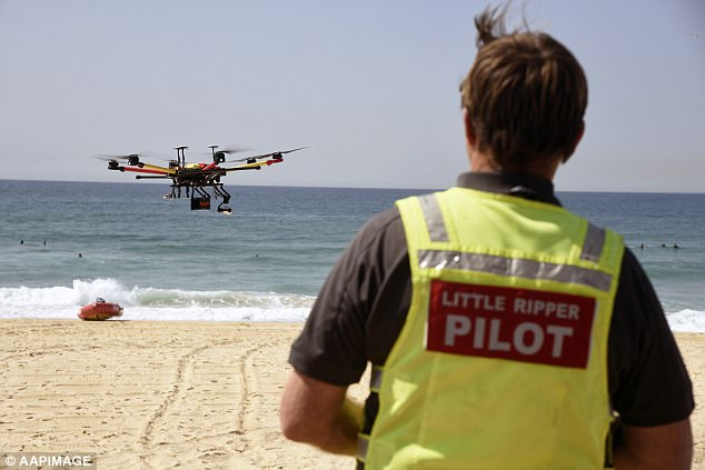 Two teenage swimmers who were sucked out to sea in a rip have been rescued by the Westpac Little Ripper drone in a world-first operation. The drone is pictured during a previous patrol
