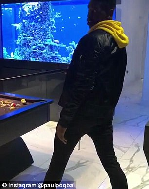 The United star wore a yellow hoodie and black jacket in the pool table video