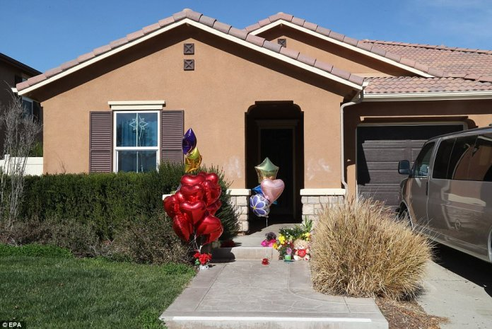 Police found the siblings inside their family home (above) after the 17-year-old girl managed to escape through a window and call 911 with a cell phone she had found in the house. On Thursday, balloon displays, flowers and teddy bears were left at the house for the children