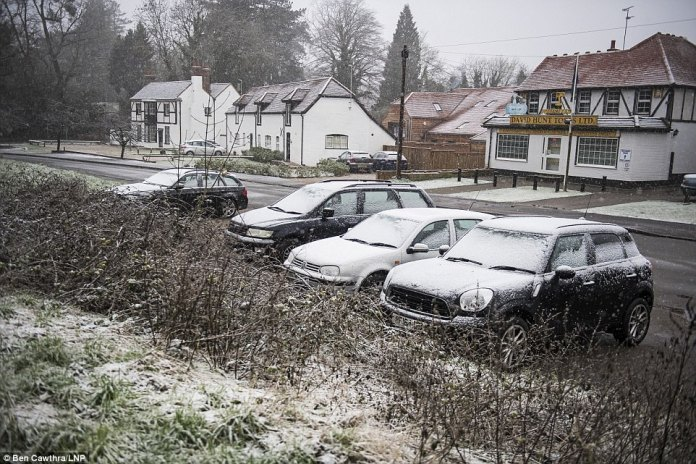 Drivers will be met with snow covering their cars in Maidenhead, Berkshire, today, as the cold weather continues