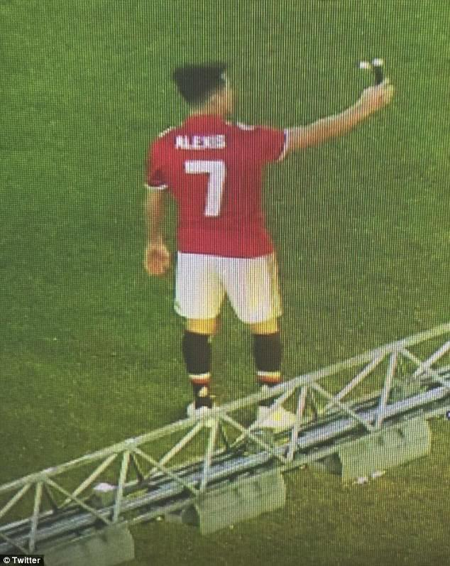 Alexis Sanchez has posed for official photographs ahead of his Manchester United move