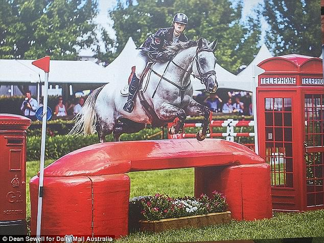Equestrian Olivia Inglis shown jumping in a poster which was displayed outside her funeral