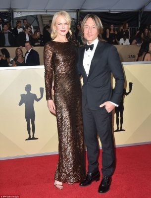 Date night! Nicole Kidman chose a sparkling copper colored gown by Armani Prive; she arrived with her husband, singer Keith Urban, who wore a Armani suit