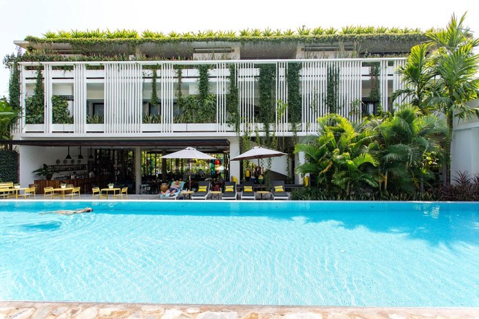 The hotel in the north west of Cambodia, pictured, boasts 50's-inspired contemporary design, complemented by large green areas and vertical gardens, 35 super stylish guestrooms, a 20-metre pool, spa, gym and open air poolside restaurant