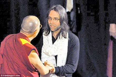Triumph: This is the moment the Dalai Lama met Keith Raniere, the leader of NXIVM, the self-help organization accused of being a sex cult which brands women. It was the culmination of a $1 million gift to the Buddhist leader for his good causes and hailed as a victory by NXIVM