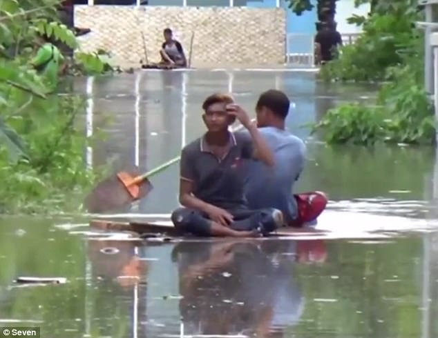 Even locals were forced to throw together a make shift raft in order to paddle down the main streets