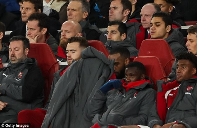 Henrikh Mkhitaryan watches from the stands during Arsenal's win over Chelsea