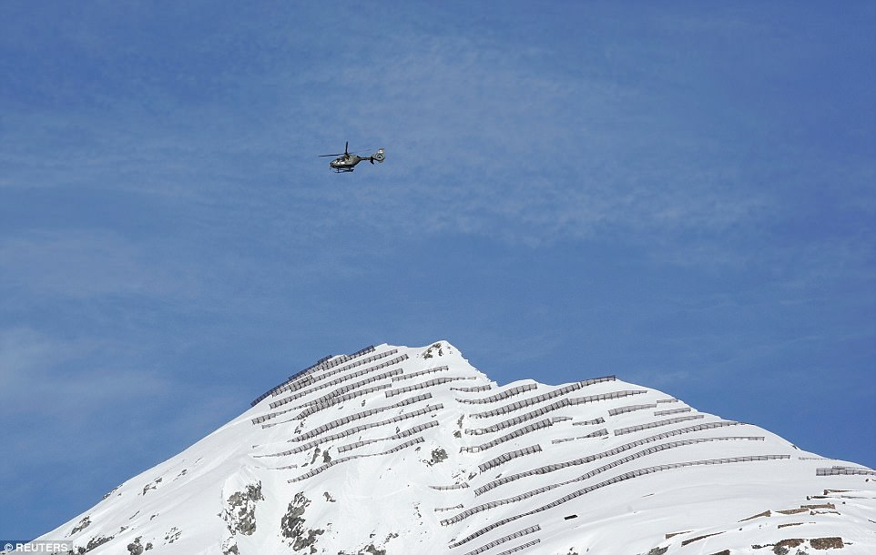 A Swiss Army helicopter patrols the skies above Davos, where the World Economic Forum is being held this week