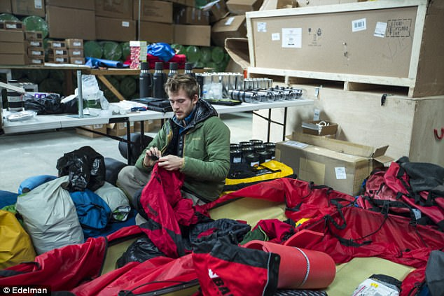 Barney Swan, pictured preparing for the expedition, said all the energy used in getting to Antarctica would be returned through reforestation and new technology to filter CO2