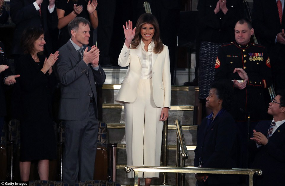 The First Lady waves to the audience who greeted her with a standing applause