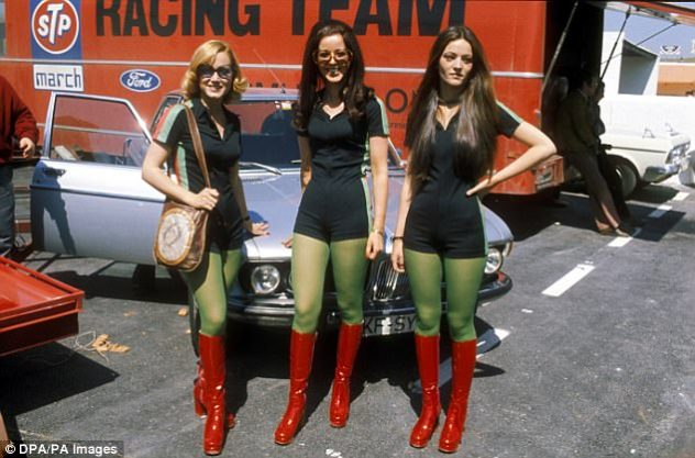 STP pit babes in front of the March-Ford truck during the 1971 season, wearing tight-fitting lycra playsuits and red PVC boots