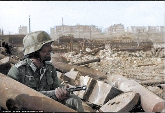 A lone German lieutenant sits among the ruins of a Stalingrad factory. On August 23rd 1942, the German 16th were tasked with destroying the Stalingrad Tractor Factory - which had been refitted to manufacture tanks