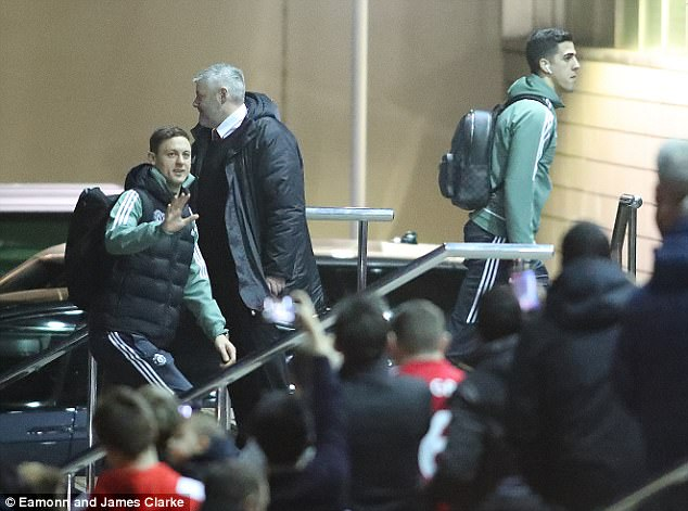 Midfield enforcer Nemanja Matic (left) smiles at waves at the supporters on Friday night