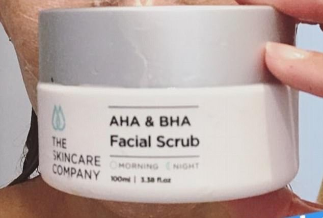 Facial scrub:Pictured from above the chest, Rebecca's wet hair was pulled back off her face, which she'd lathered in an AHA & BHA Facial Scrub from The Skincare Company