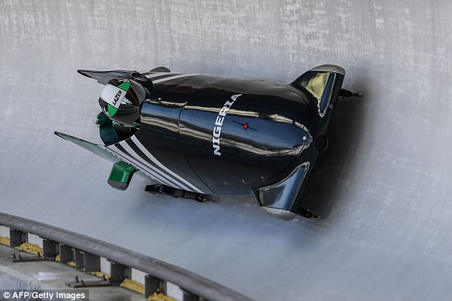 Ready to rumble: Team leader and driver Ms Adigun take a turn during the first unofficial bobsleigh women training session at the Olympic Sliding Centre on Wednesday