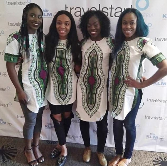 Pride: The bobsleigh team, right, pose up a storm with Ms Adeagbo, who is competing in skeleton for Nigeria
