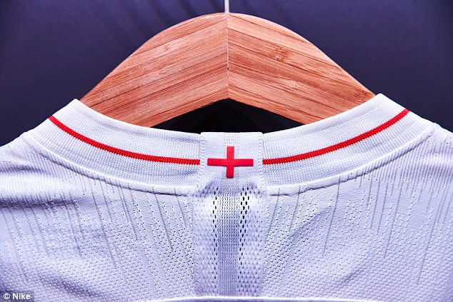 The white home top will feature red piping across the collar and a St George's cross