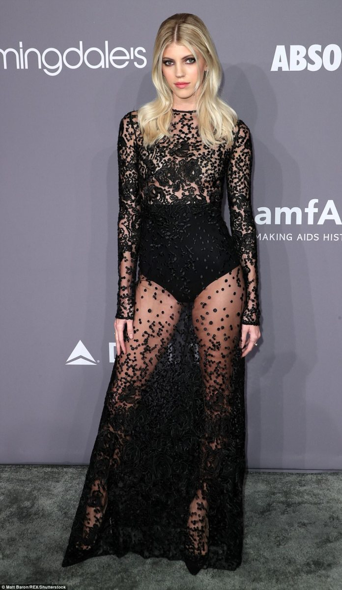 Devon Windsor, 23, turned heads in a sheer dress with black patterns and long sleeves and a black undergarment to protect her modesty