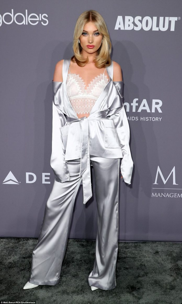 VS Angel Elsa Hosk, 29, arrived at the event in a white camisole top and a shiny silver pajama-style suit