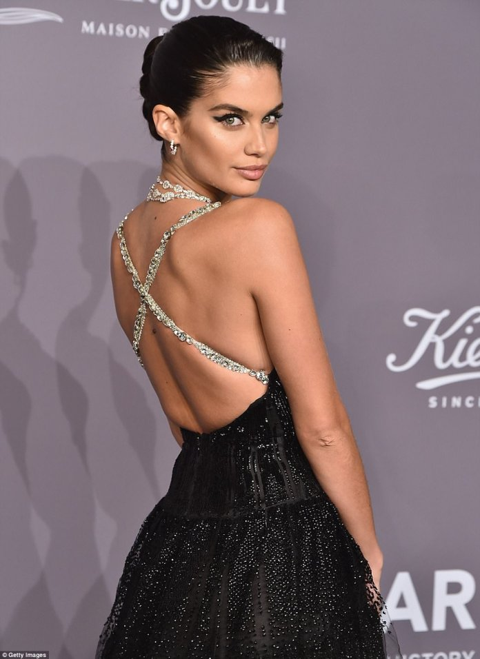 The silver embellished straps criss-crossed her back and she accessorized with diamonds