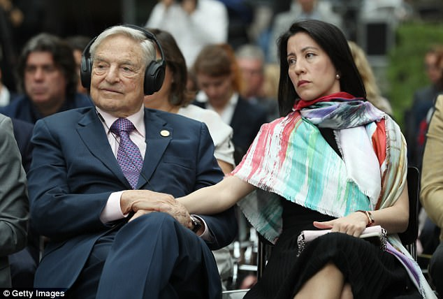 George Soros, pictured here with his wife Tamiko Bolton, has been criticised for his Brexit intervention but denies he is attempting to undermine democracy